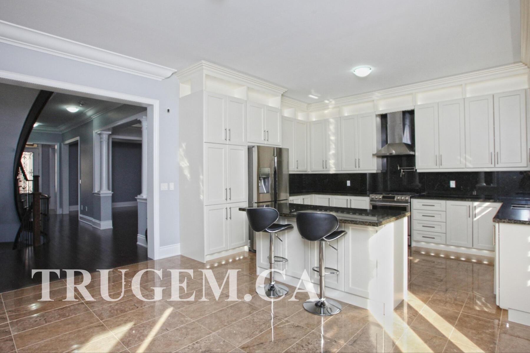 white cabinets black backsplash