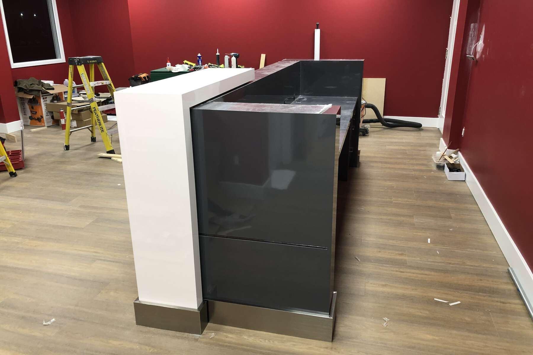 small black reception desk