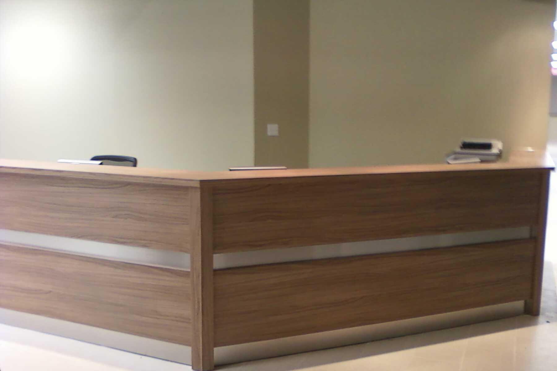 long wooden reception desk