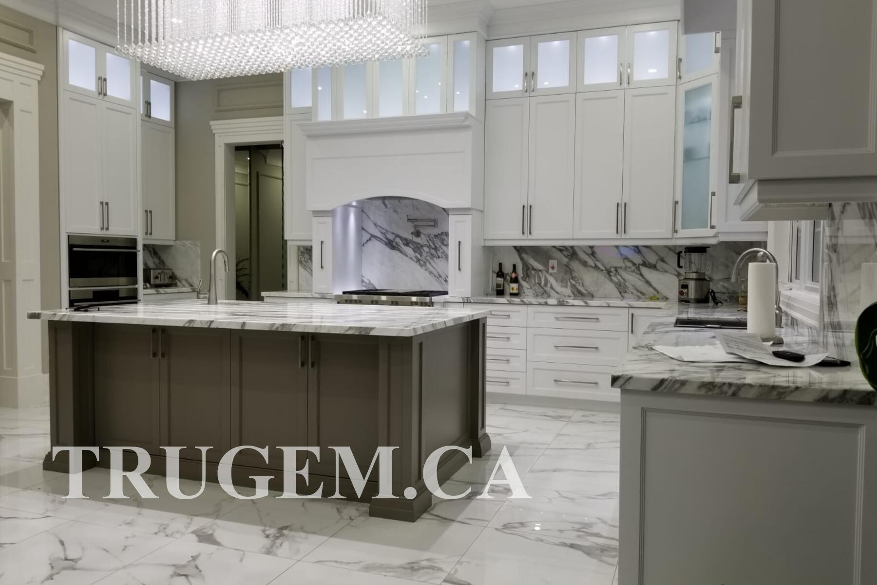 white cabinets with grey island