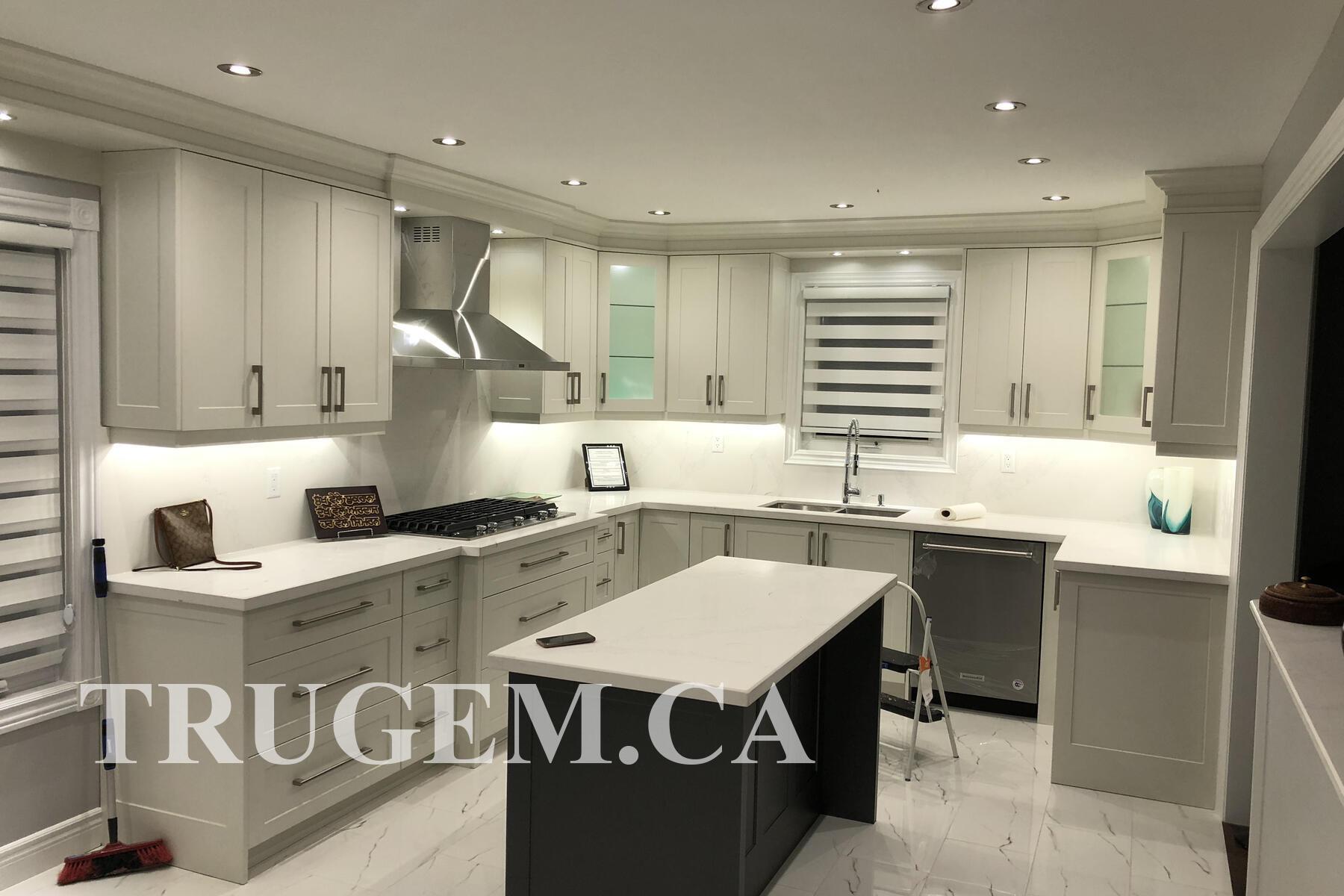 white kitchen with dark grey island